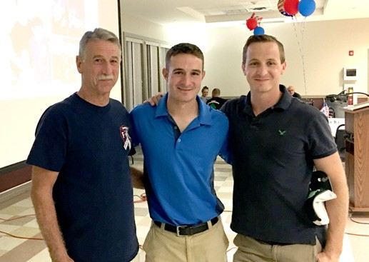 Chris Roberto (center) is flanked by his dad, Vincent Roberto (left) and his brother, Andrew Roberto at Friday's welcome home gala in Mahopac. Photo By Matt Bondi