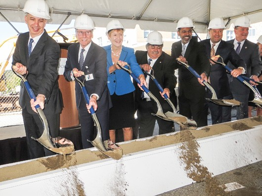 Hospital officials and dignitaries at the traditional groundbreaking ceremony. Photo by Eric Gross