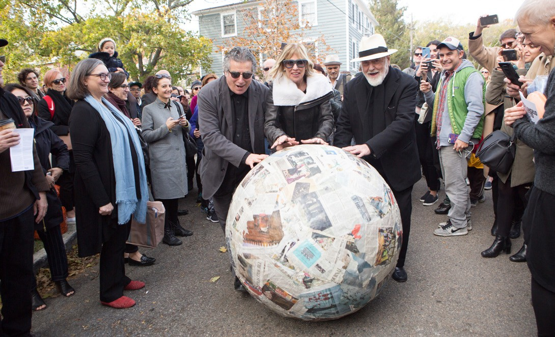 Giorgio Spanu, Nancy Olnick and Michelangelo Pistoletto roll the giant newspaper ball. Photo Provided