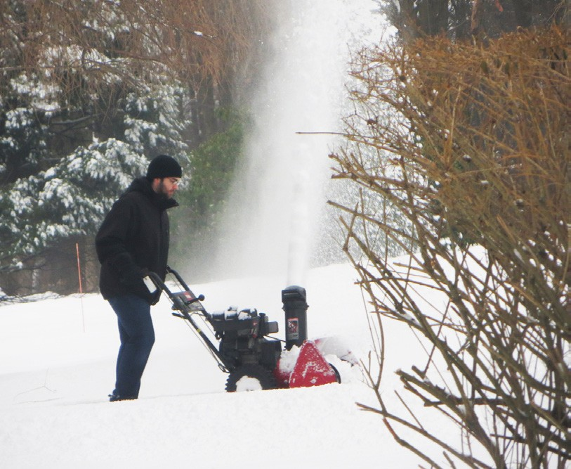 The clean-up began on Friday morning when the sounds of snow blowers were heard countywide. But cold temps stuck around through Saturday night. Photo by Eric Gross
