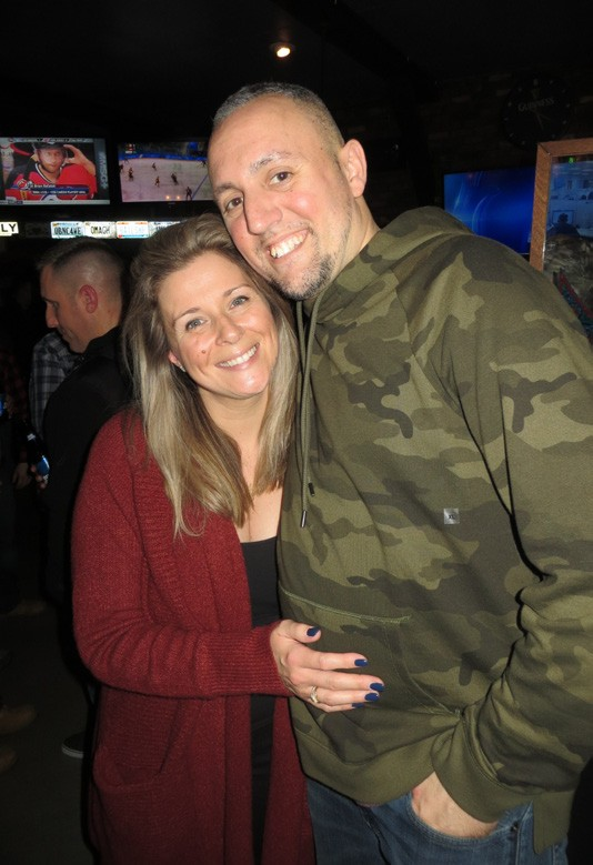 Deputy Michael Schmidt and his wife, Sara, are overwhelmed by the response at Friday's gathering. Photo by Eric Gross