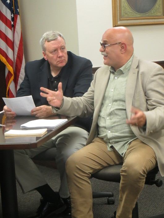 Vincent Tamagna discusses OTB revenues with members of the county legislature as Commissioner of Finance William Carlin listens. Photo by Eric Gross