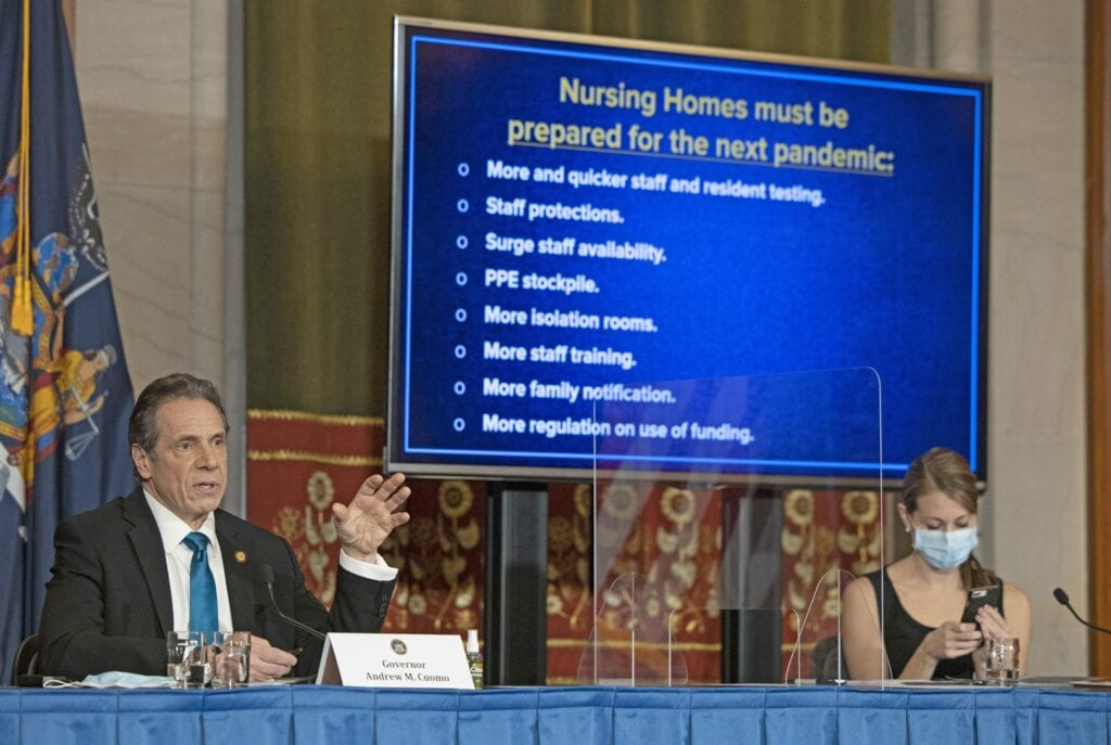 Below, Governor Andrew M. Cuomo provides a coronavirus update on Friday from the Red Room at the State Capitol. His top aide, the Secretary to the Governor, Melissa DeRosa, is at right. Photo/Mike Groll/Office of Governor Andrew M. Cuomo