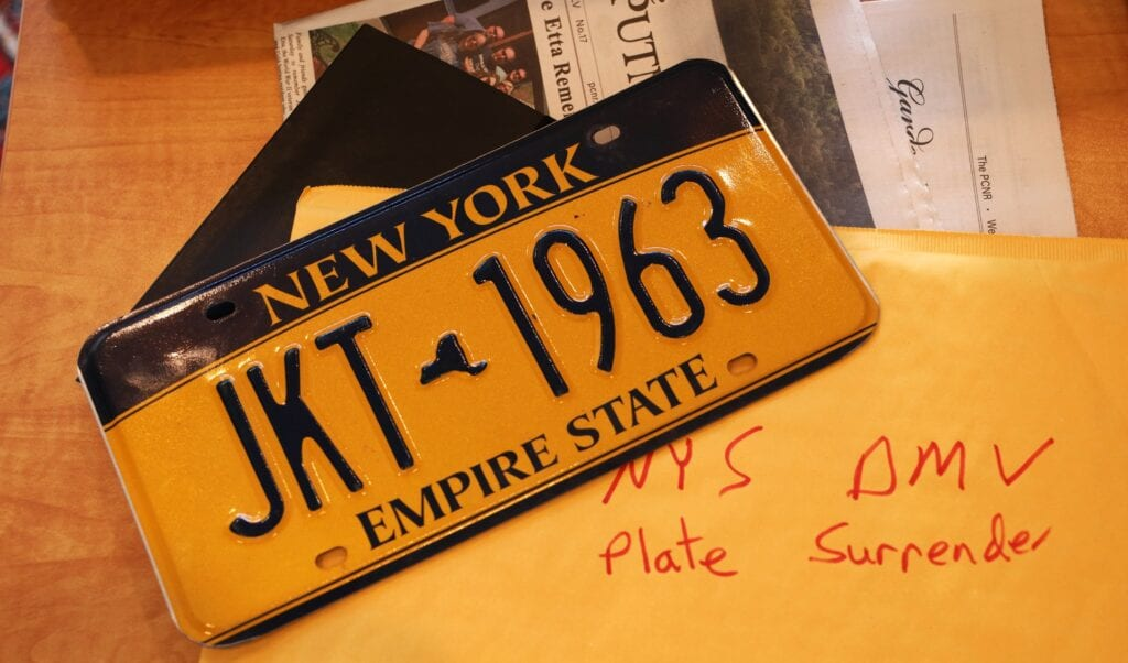 """Below, the writer's license plates from a 2013 Subaru, on their circuitous way to being surrendered. Check out in particular their """"good operating condition"""". Photo/ Douglas Cunningham"""